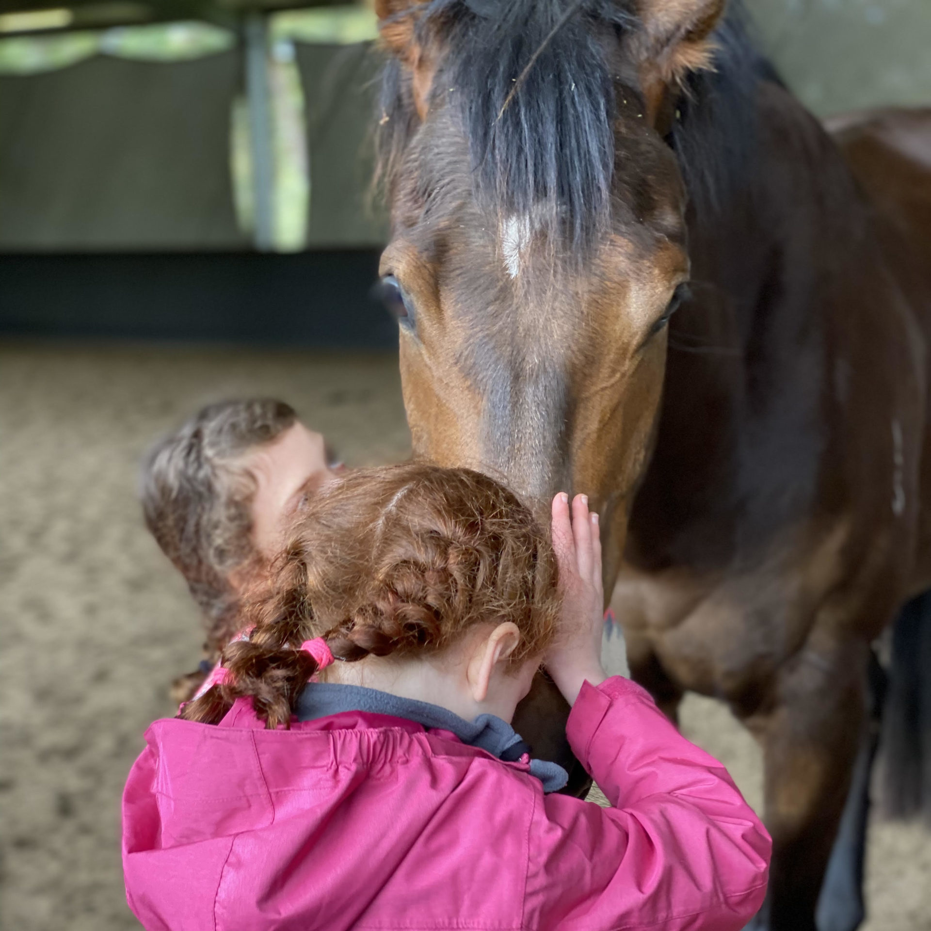 instructor and boy next to horse