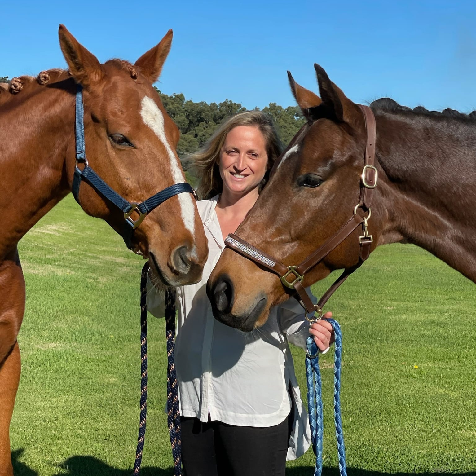 Joanna Paterson next to horse eating